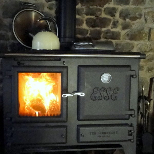 The stunning Esse Ironheart Stove.  Light it, curl up on the sofa and watch the flames as you cook your dinner in its oven !